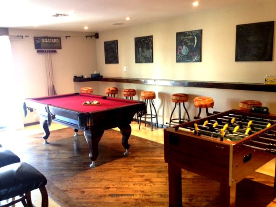 Foosball, pool table, darts, chalk boards, music and flat screen all in one make for a game room dream.