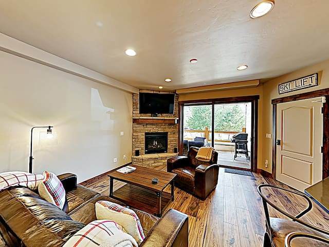 """Cozy up in front of the gas fireplace and watch a movie on the 54"""" Roku TV."""
