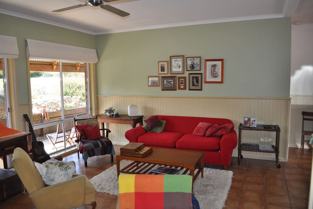 The living room with the big red fold out couch.