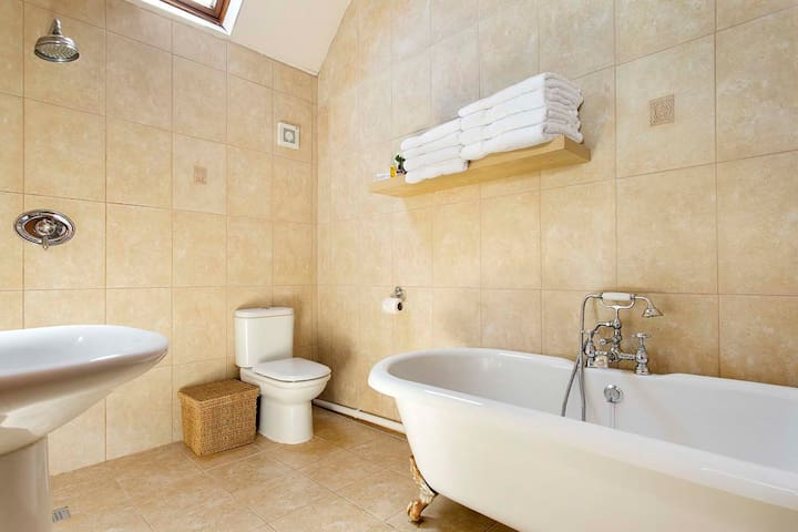 Luxurious roll top bath and full wet room