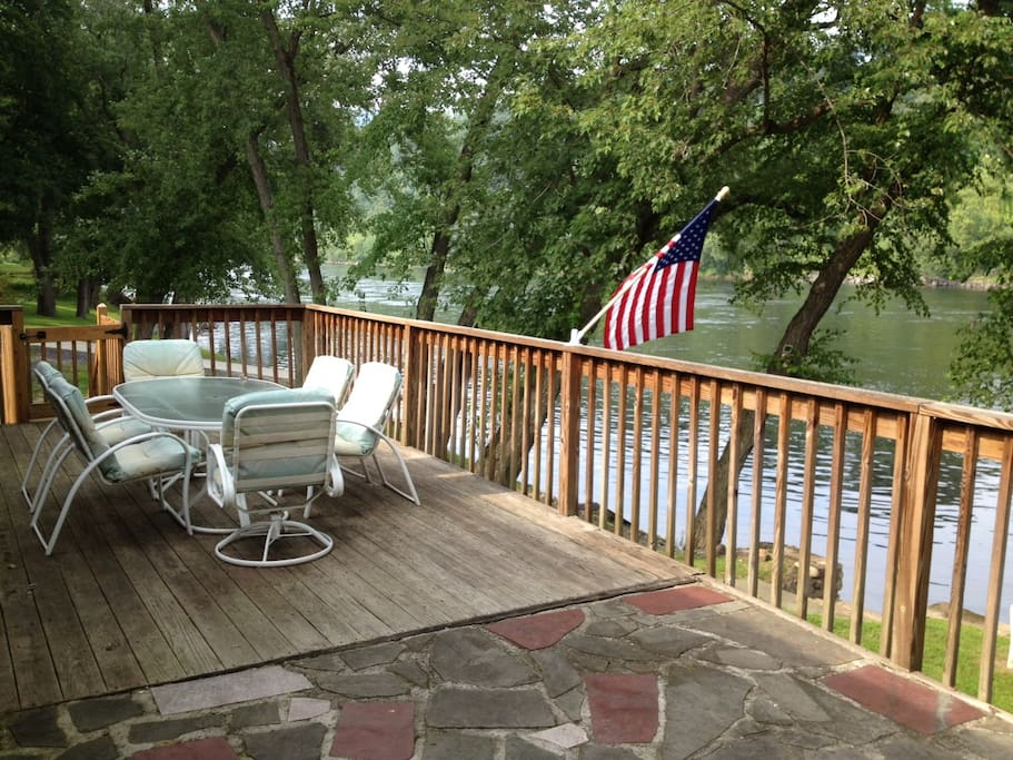 Porch with outdoor seating overlooking the Delaware River