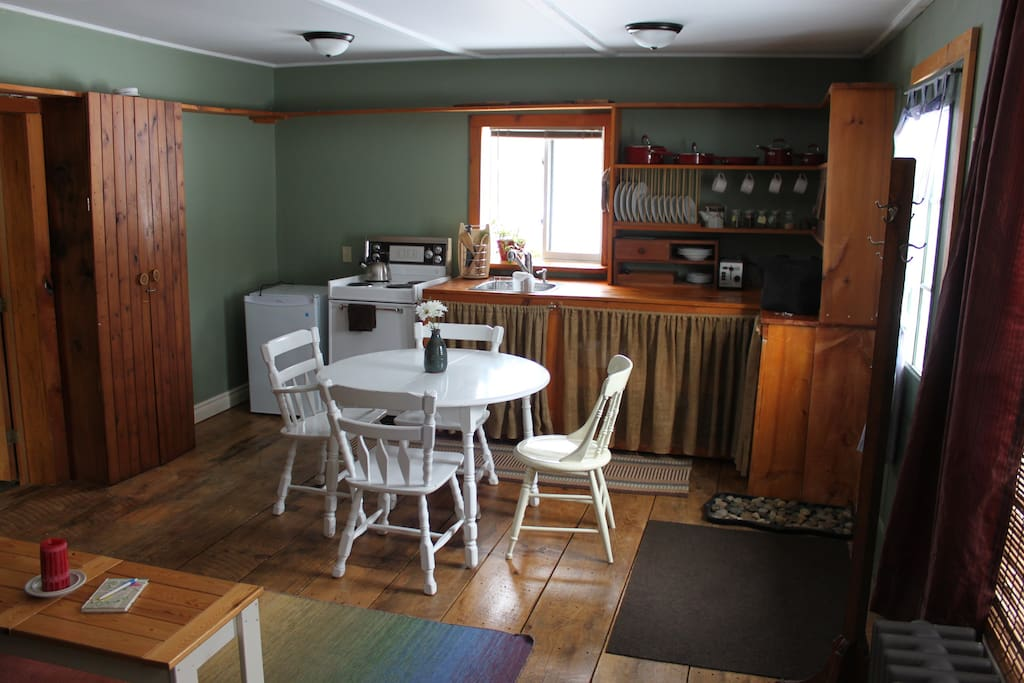 Small country kitchen in the Karma Cabin is stocked with  organic tea & locally roasted coffee.