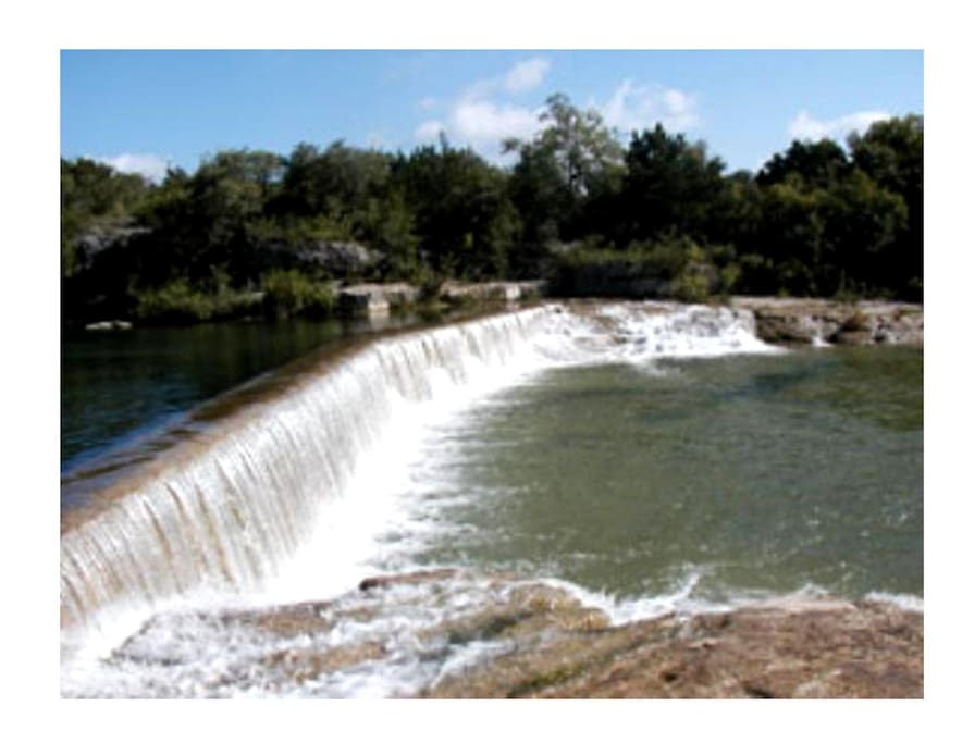 Famous Blue Hole dam and swimming . The trail to get to the river is across the street from our home. Texas can be hot and dry and then turn wet and wild. A great place to visit in downtown.