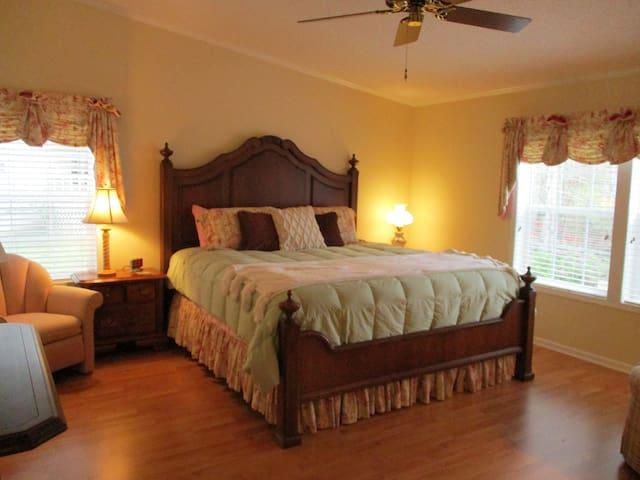 Large master bedroom. King size bed.