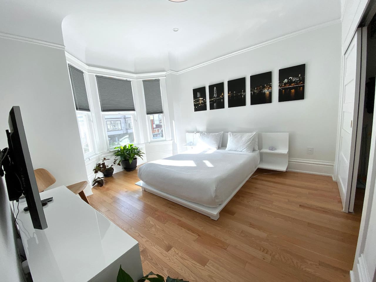 Large, bright and comfortable bedroom with queen-sized bed, view overlooking Castro St. and 18th, TV with Dish Network and Netflix...