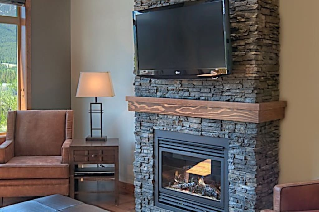 Relax in front of the beautiful stone fireplace after a day outside