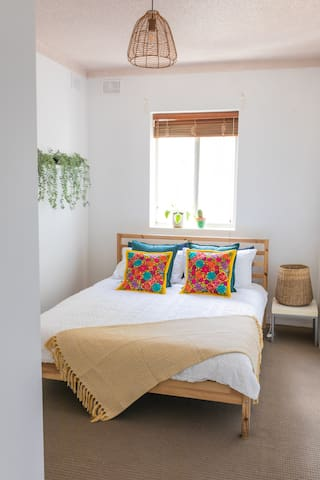 Mexico-inspired second bedroom with timber double bed