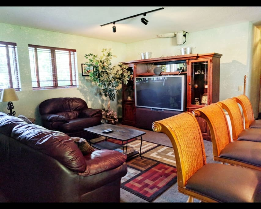 Private living room area with large television.