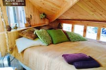 Queen bed, sleeps two inside the Hobbit House