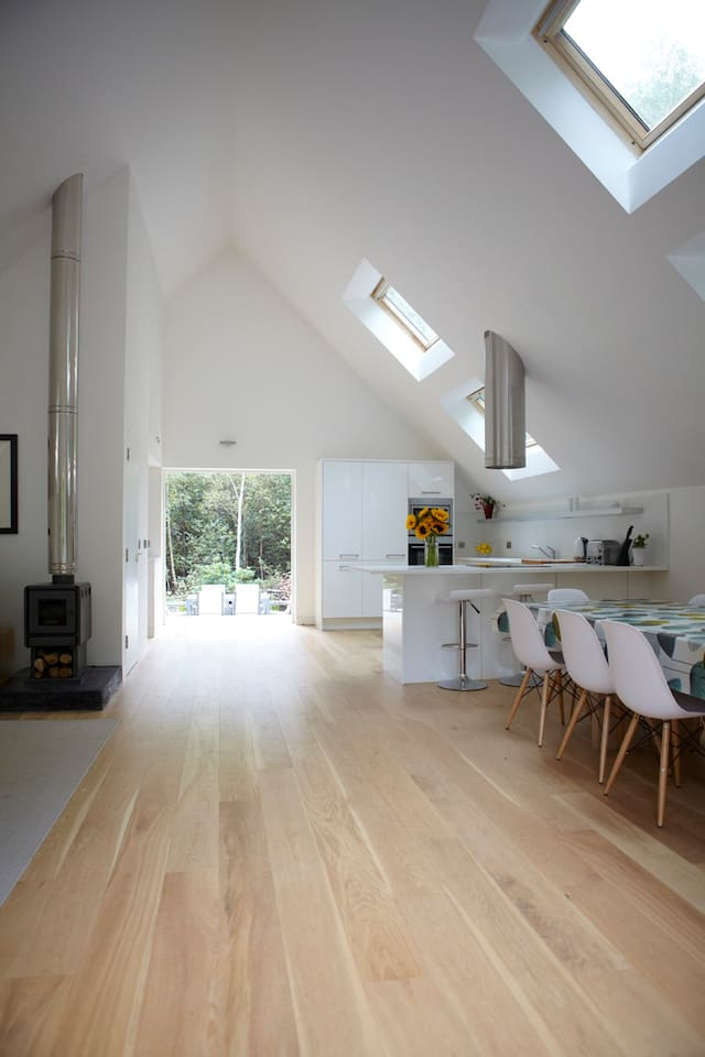 Spacious open plan living/dining space with views to the woods