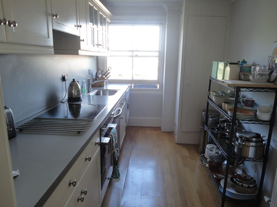 hi-spec shared kitchen with washer-dryer, new oven and hob.