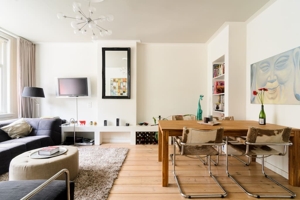 The living room with dining area