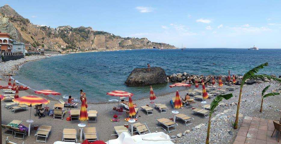 little beach in Giardini Naxos