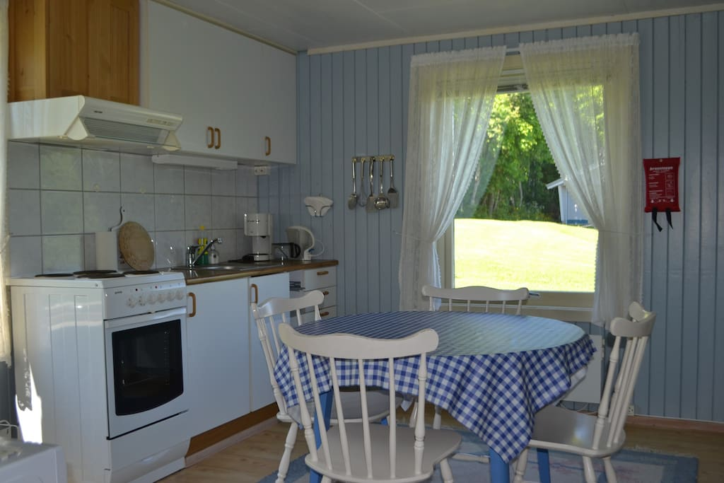 Kitchen with electric oven (4 hobs), refrigerator with top freezer, microwave, coffee machine, toaster, electric kettle