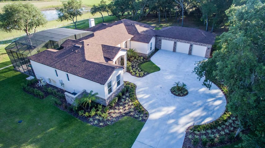 Mediterranean Equestrian Villa with In ground Pool on 5 acre picturesque lot