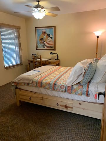 Double bed with cozy pillow and linens, with view of the courtyard.