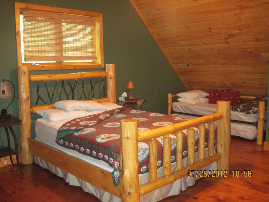 Hand made log queen bed.  Pull-out two single beds.  Ideal for families.