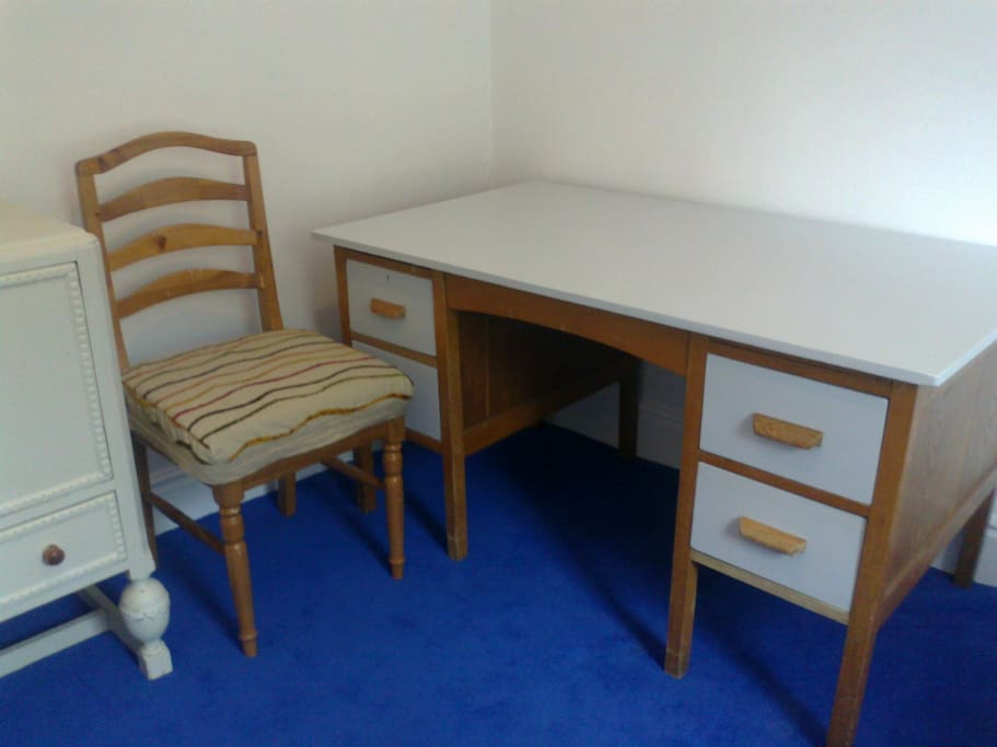 Full sized desk for study or business.  Sockets close for laptop and hairdryer.