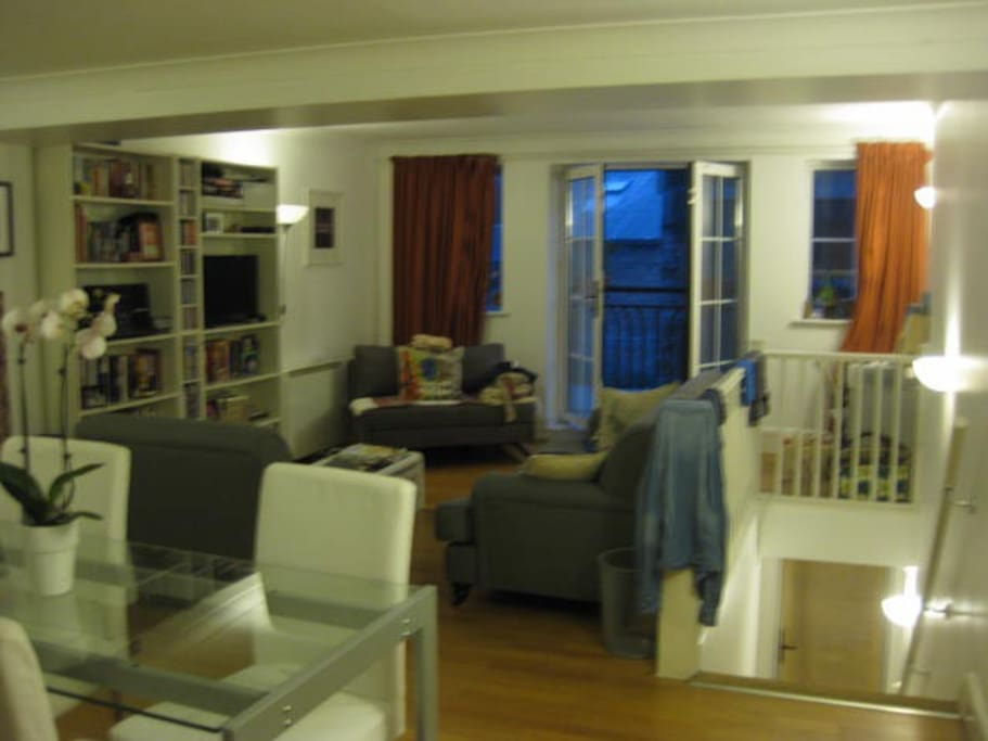 Large upstairs living dining space with french windows