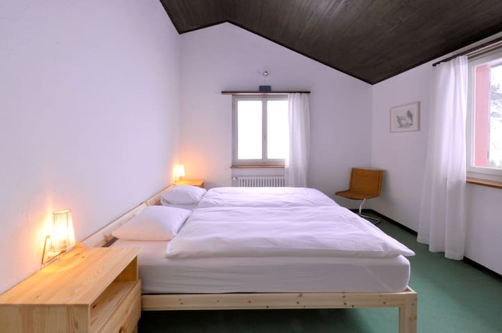 Sleeping room with double or two single beds