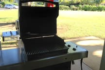 Two Weber grills, each with 3 burners.