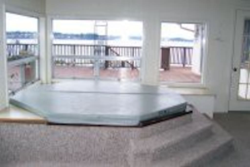 The 8 person hot tub sits in the atrium overlooking the bay.