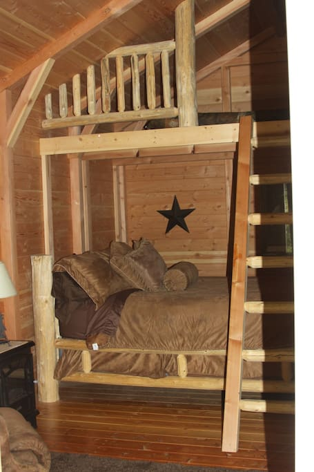Cabin is a studio, offering a queen bed below and a double bed in the loft.
