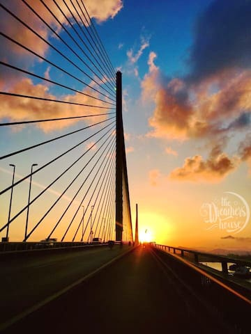 The sunset on Bai Chay bridge - the cable-stayed bridge with the world's largest span length.