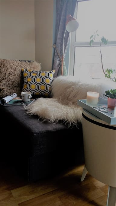 The Lounge is where the sofa unfolds to a comfortable double. Relax on the chaise with a view into Portishead.