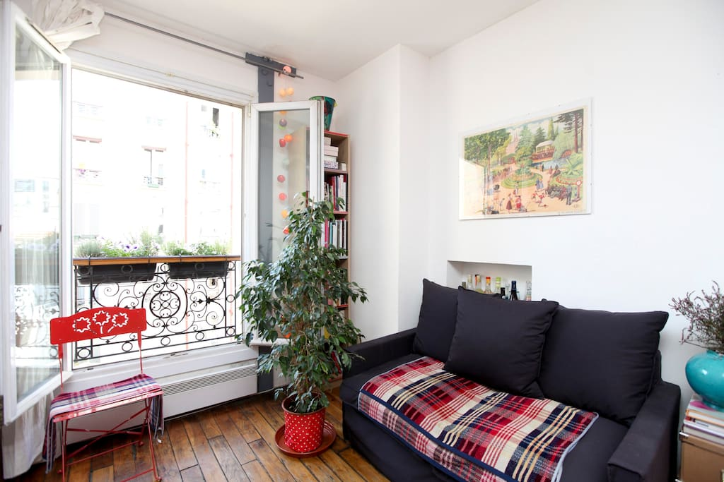 The sofa corner, windows on the calm yard
