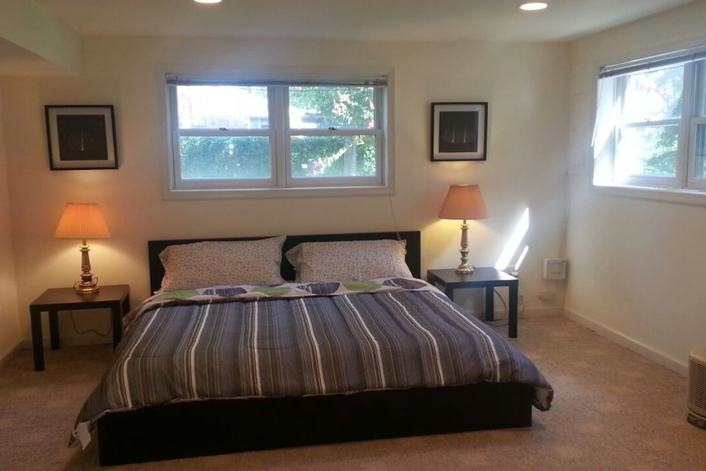 King Bed, two windows, dresser, closet, portrait mirror and work table; room is 275 sqft