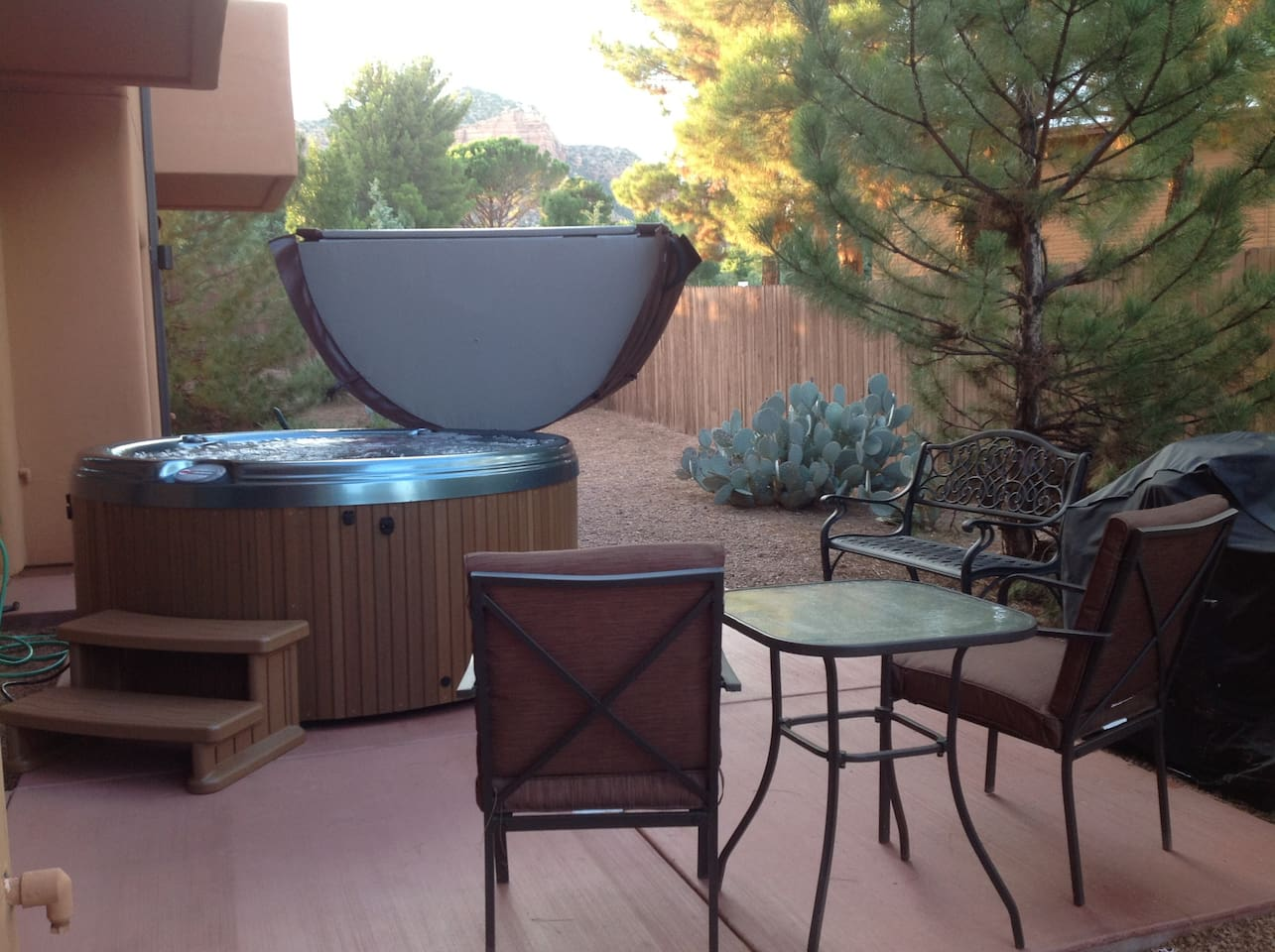 back patio hot tub and outdoor dining