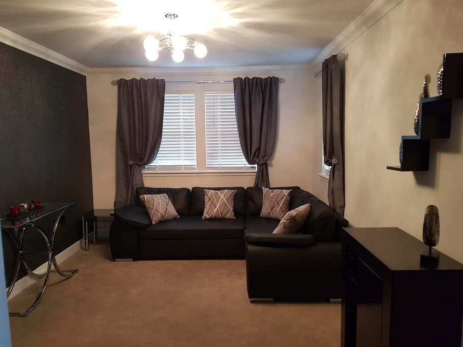 Comfortable lounge with leather corner suite, wall mounted tv/dvd and sound bar