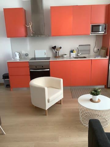 Nice modern salmon colour kitchenette with fridge/freezer, cooker, hobb, microwave, dishwasher, washing machine, coffee maker, toaster, kettle etc.