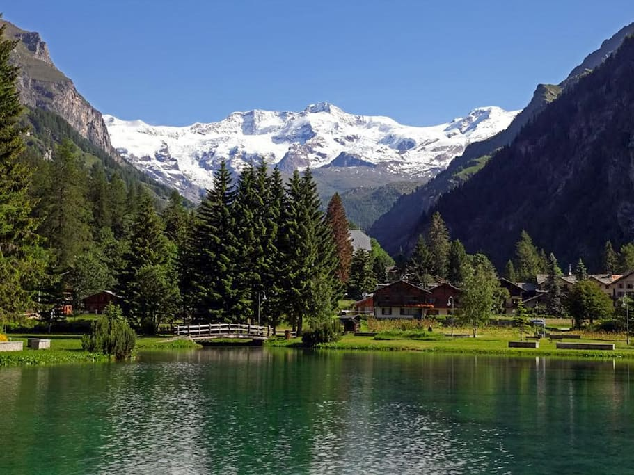 The small lake of Gressoney-La-Trinité, facing Monte Rosa