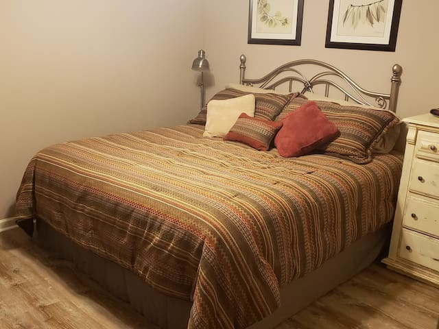 You will sleep great on this comfy king sized bed with pillow top.  Bedroom includes full closet, two dressers, and flat screen TV with VHS movies.