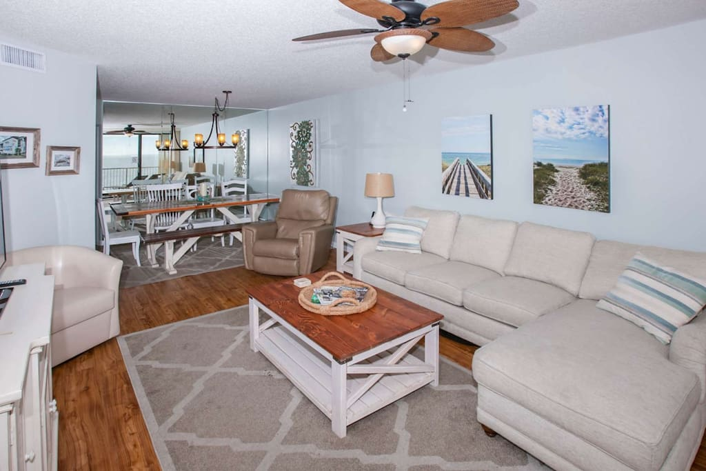 Living room with seating for 7 and ceiling fan