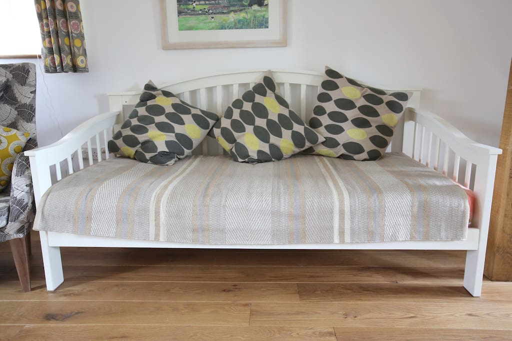 Single bed in sitting room