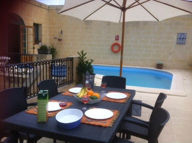 Outdoor pool dining and BBQ area
