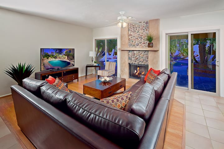 """Relax in the cozy living room with large sleeper sectional and massive 60"""" TV!"""