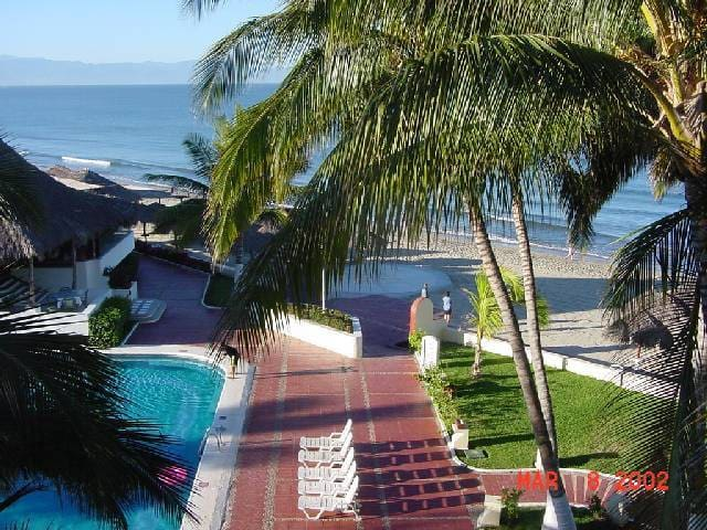 View from balconies overlooking pool and beach areas.