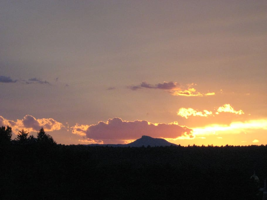 Here is the view from the back yard at sunset. The mountain is called Camels Hump.