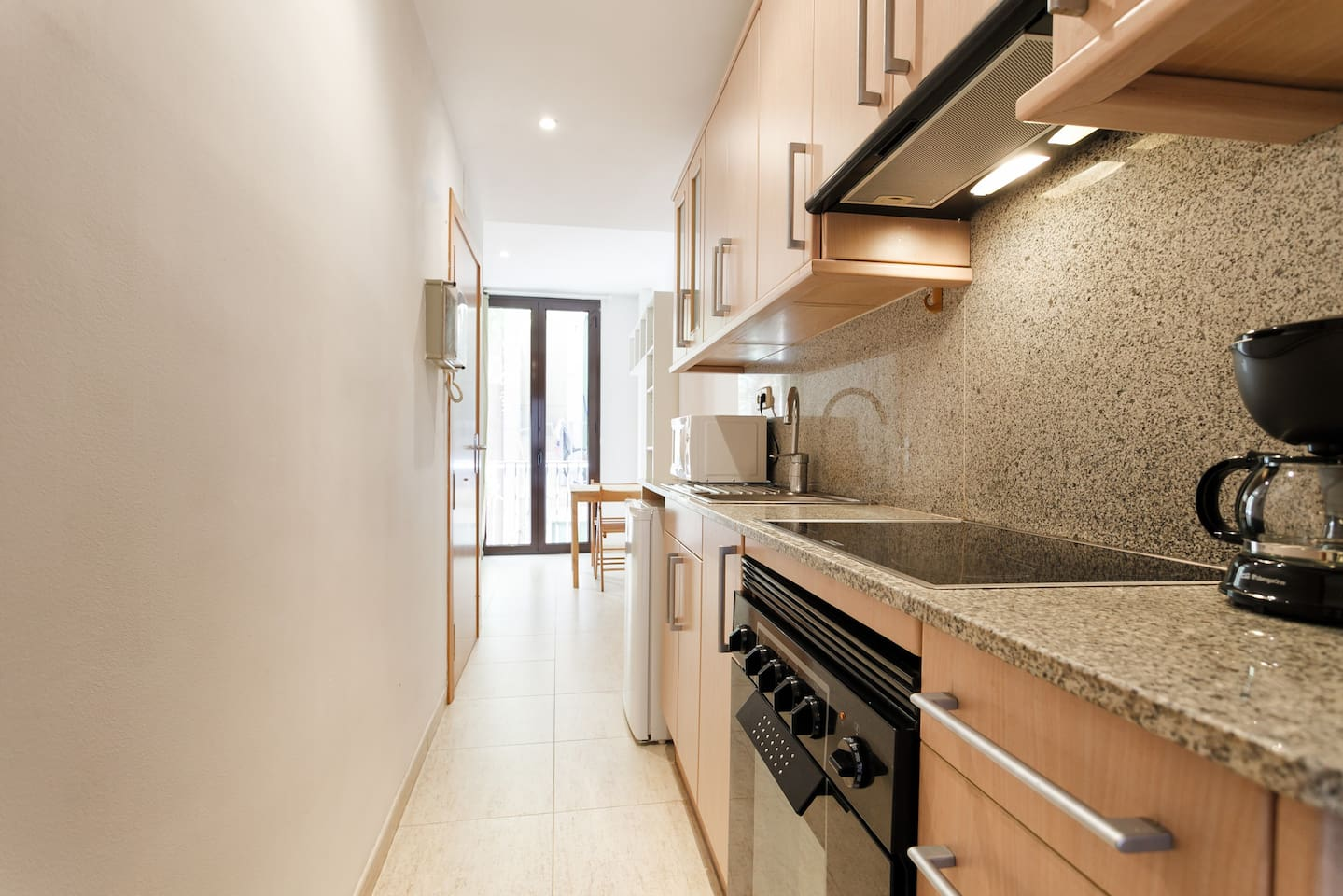 Hallway + Modern Kitchen( refrigerator ,coffee maker, kettle, microwave.oven, etcc..)