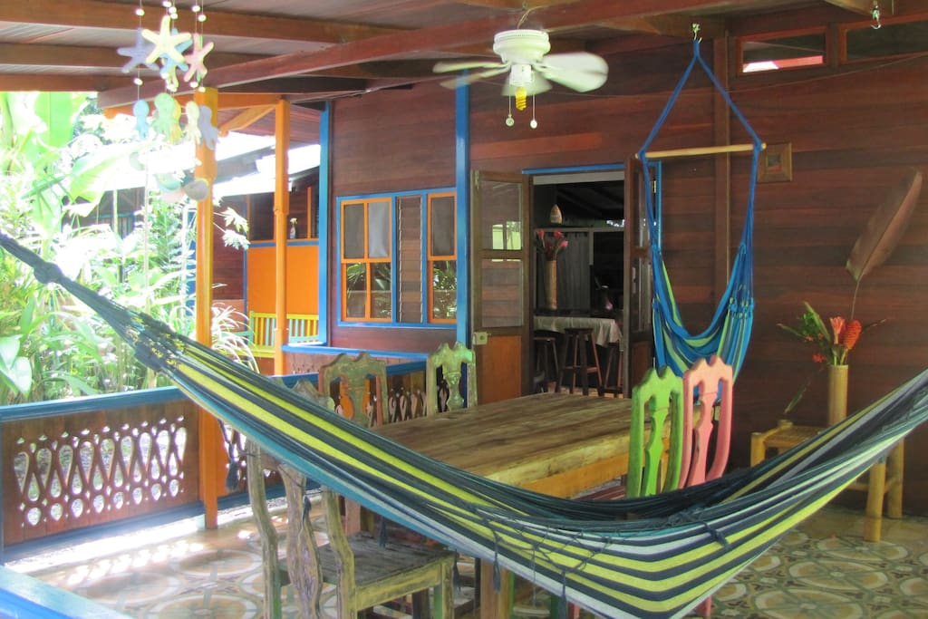Welcome! Large porch with dining table and two hammocks facing the garden and frog pond.
