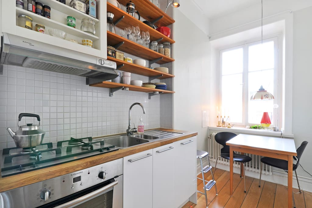 The kitchen is light and modern and has space for three persons. It also views the courtyard.