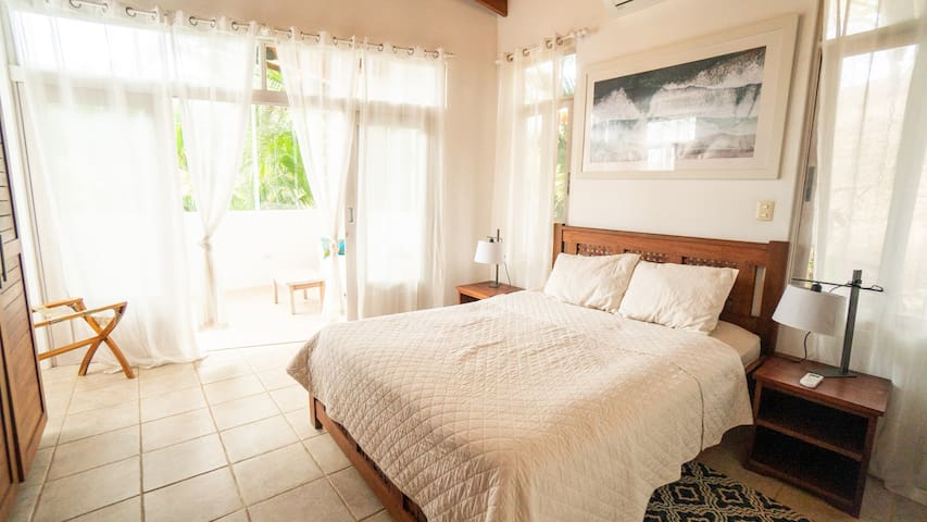 The master bedroom offers a private den or office space.