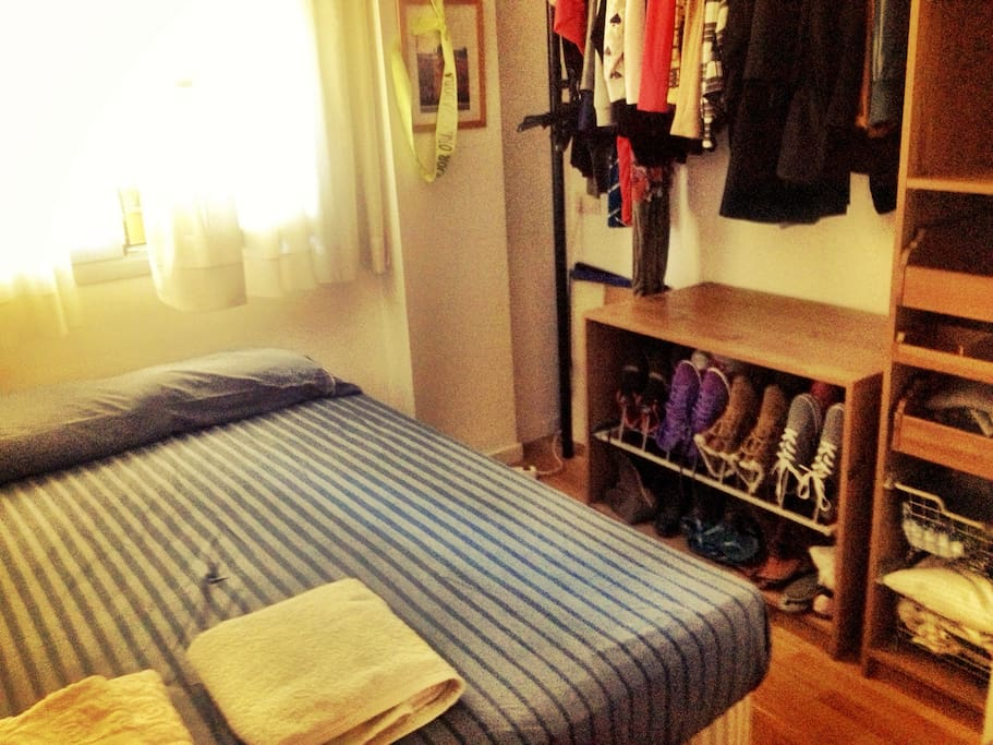 Double room with a good mattress, window enclosure and blinds.