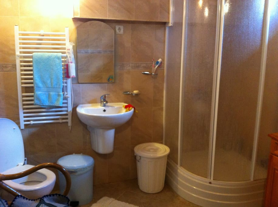 Full bathroom with separate bath and shower