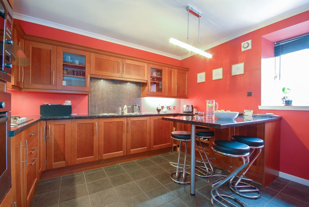 Dining kitchen, help yourself to fruit, crusty bread, minty water and italian coffee
