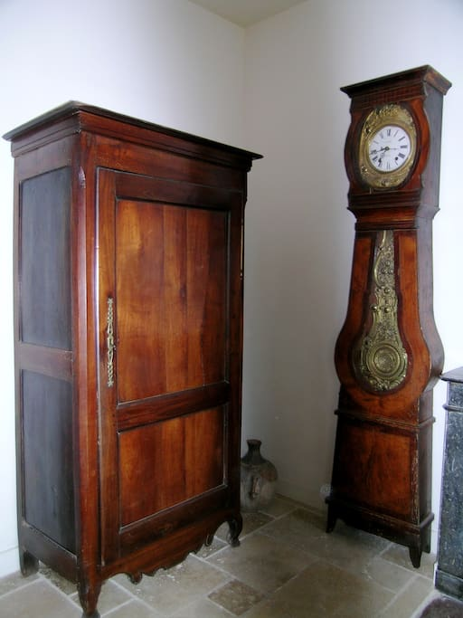 Antique cupboard and pendulum in the living room
